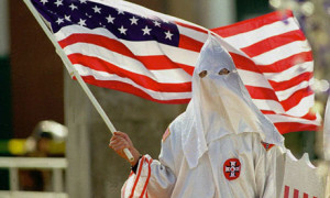 A member of the American Knights of the Ku Klux Klan participates in a demonstration