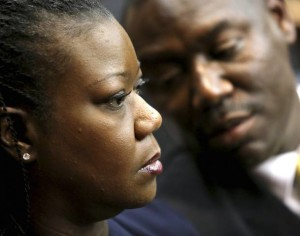 Sybrina Fulton talks with her attorney Benjamin Crump during a pre-trial hearing for George Zimmerman in Sanford