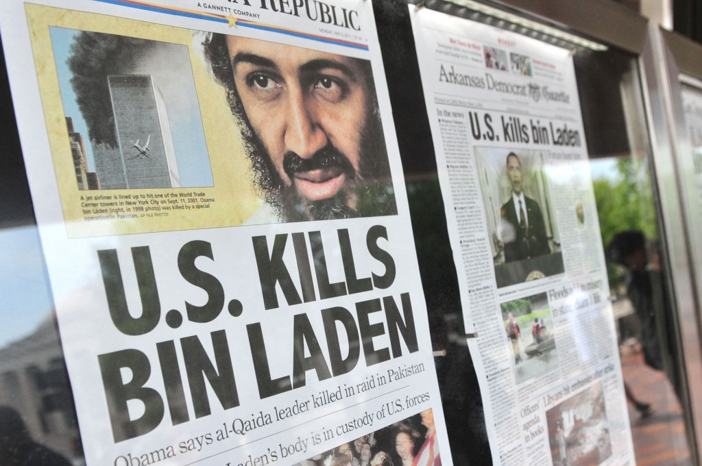 Front pages headlines from around the country that announce the death of Al-Qaida terror leader Osama bin Laden are seen in front of the Newseum in Washington on May 2, 2011.   UPI/Kevin Dietsch