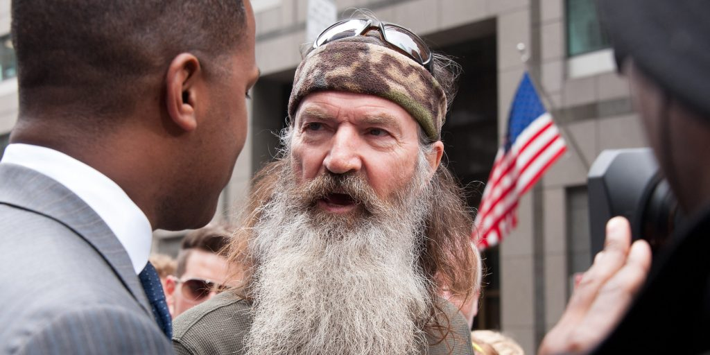 "NEW YORK, NY - MAY 07:  Phil Robertson visits ""Extra"" in Times Square on May 7, 2013 in New York City.  (Photo by D Dipasupil/Getty Images for Extra)"
