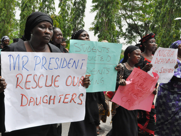 Unidentified mothers call for the president to help, during a demonstration with others who have daughters among the kidnapped school girls of government secondary school Chibok, Tuesday April 29, 2014, in Abuja, Nigeria.  Two weeks after Islamic extremists stormed a remote boarding school in northeast Nigeria, more than 200 girls and young women remain missing despite a ìhot pursuitî by security forces and desperate parents heading into a dangerous forest in search of their daughters. Some dozens have managed to escape their captors, jumping from the back of an open truck or escaping into the bush from a forest hideout, although the exact number of escapees is unclear. (AP Photo/ Gbemiga Olamikan)