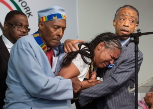 Rev. Herbert Daughtry and Rev. Al Sharpton console Esaw Garner, wife of Eric Garner Photo credit: (AP Photo/John Minchillo)